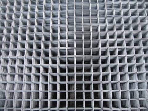 Many sheets of galvanized welded mesh panel with square holes.