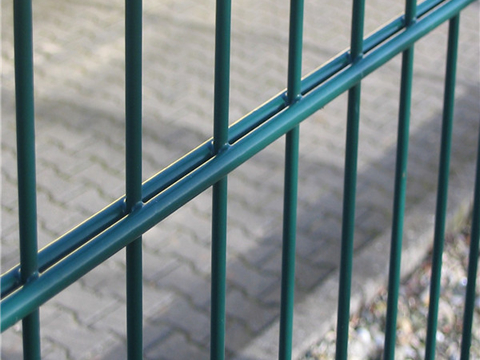 This is a green PVC double wire fence.