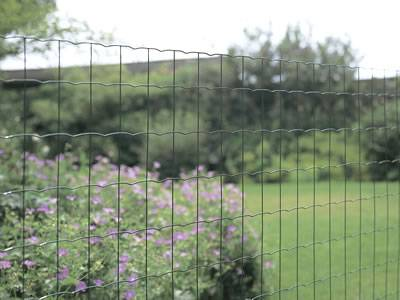 This is a beautiful garden with euro fences.