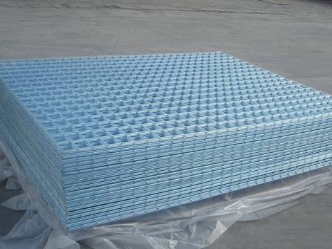 Many sheets of rectangular shape general welded wire mesh panel are placed in workshop.