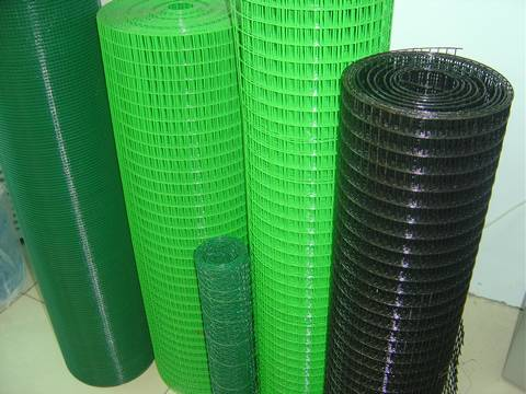 Five rolls of PVC coated welded wire mesh: two rolls in green, two rolls in dark green, and one roll in black.