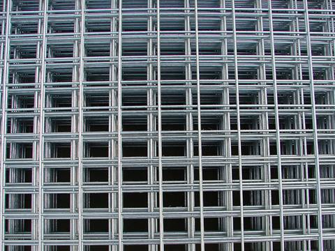 Many sheets of stainless steel welded mesh panel with rectangular holes.