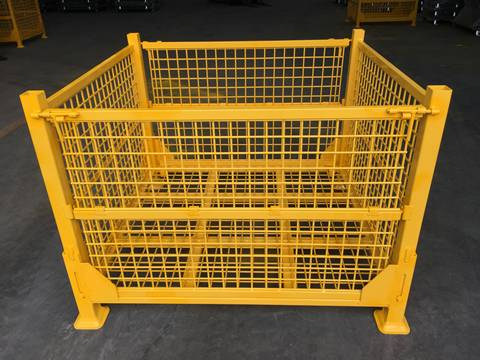 A yellow welded wire container with foldable front gate.