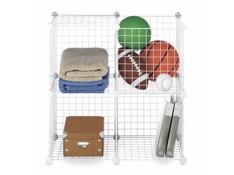 A white welded wire shelf is divided into four parts and each part is full of things.
