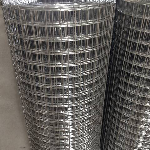 Two rolls of stainless steel welded wire mesh with big rectangular holes.
