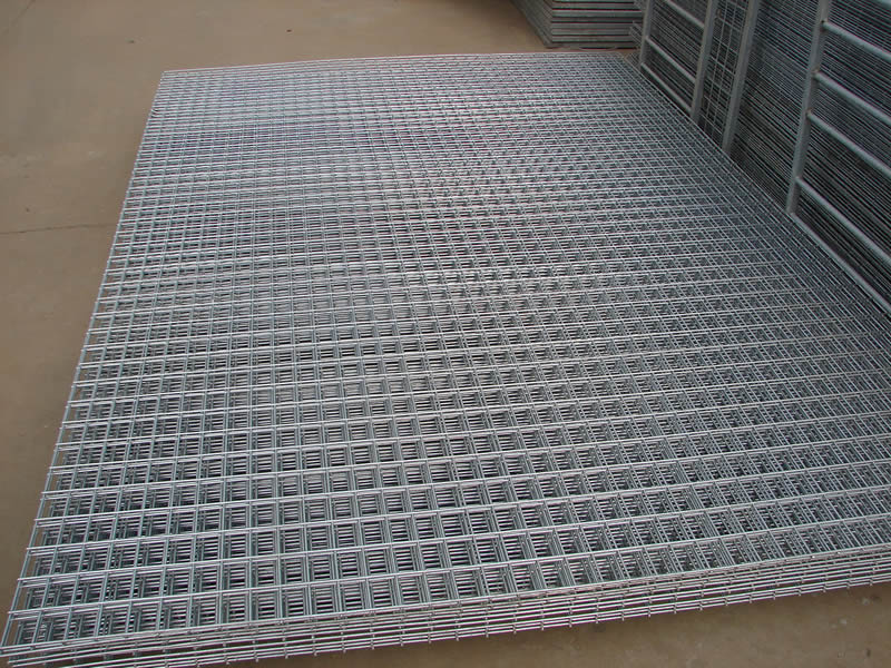 Many sheets of galvanized welded wire mesh with big rectangular holes.