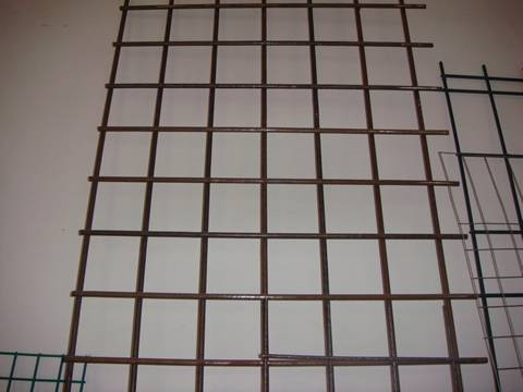A piece of floor heating mesh with square holes is made of low carbon steel.