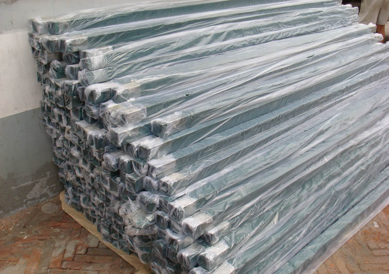 Many pieces of PVC coated rectangular shape post for chain link fence are packed with plastic film.