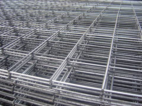 A corner of stainless steel welded mesh panel with rectangular holes.