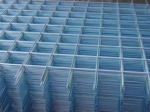 Many sheets of galvanized welded wire mesh panel with uniform square holes.