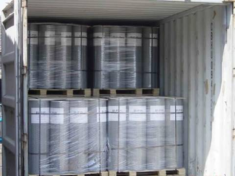 Two stacks of hot dipped galvanized wire mesh are packed with plastic film and metal belt in container.