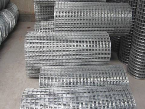 Many sheets of silver white hot dipped galvanized welded wire mesh.