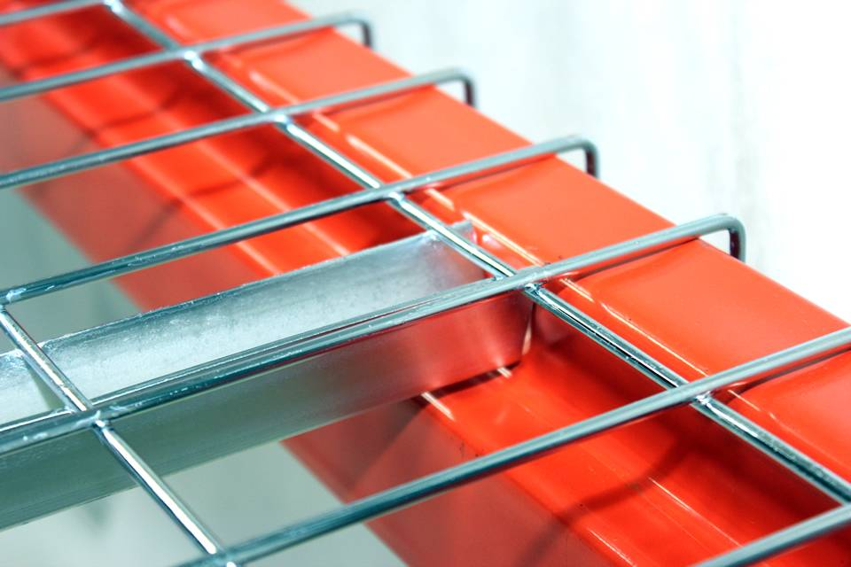 A galvanized wire mesh decking is installed on an orange metal support.