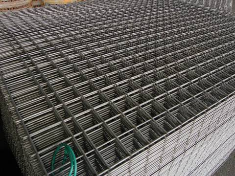 A corner of stainless steel welded mesh panel with square holes.