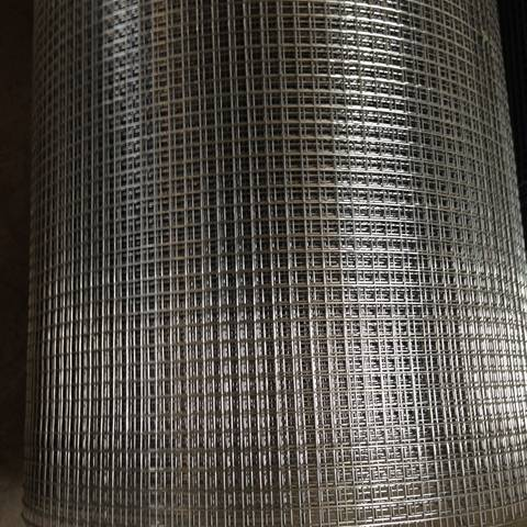 A roll of stainless steel welded wire mesh with small square holes.