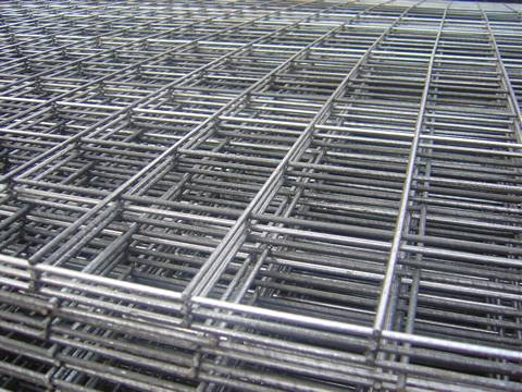 Many sheets of stainless steel welded wire mesh panel with uniform square holes.
