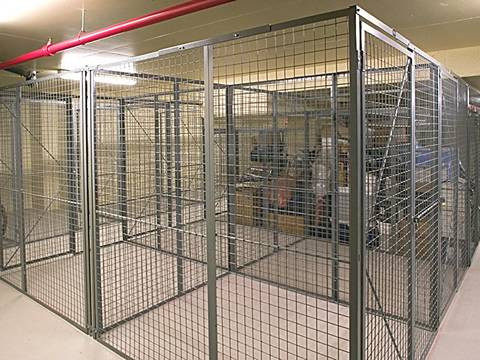 A stainless steel temporary fence container in a room.