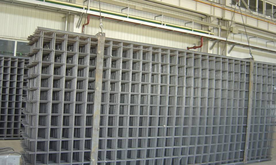 Many sheets of stainless steel welded mesh panel in workshop.