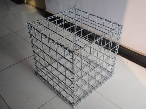 A welded gabion m box are on the ground.