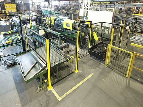 The equipment of workshop is protected by welded wire mesh partition.