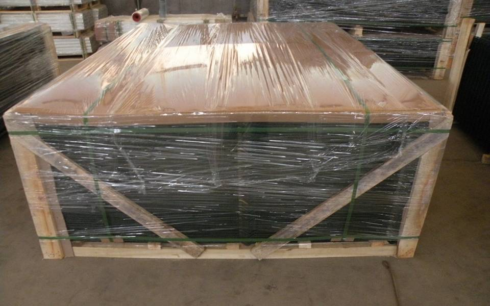 PVC coated welded mesh panel is packed in wooden box and the wooden box is covered with plastic film.
