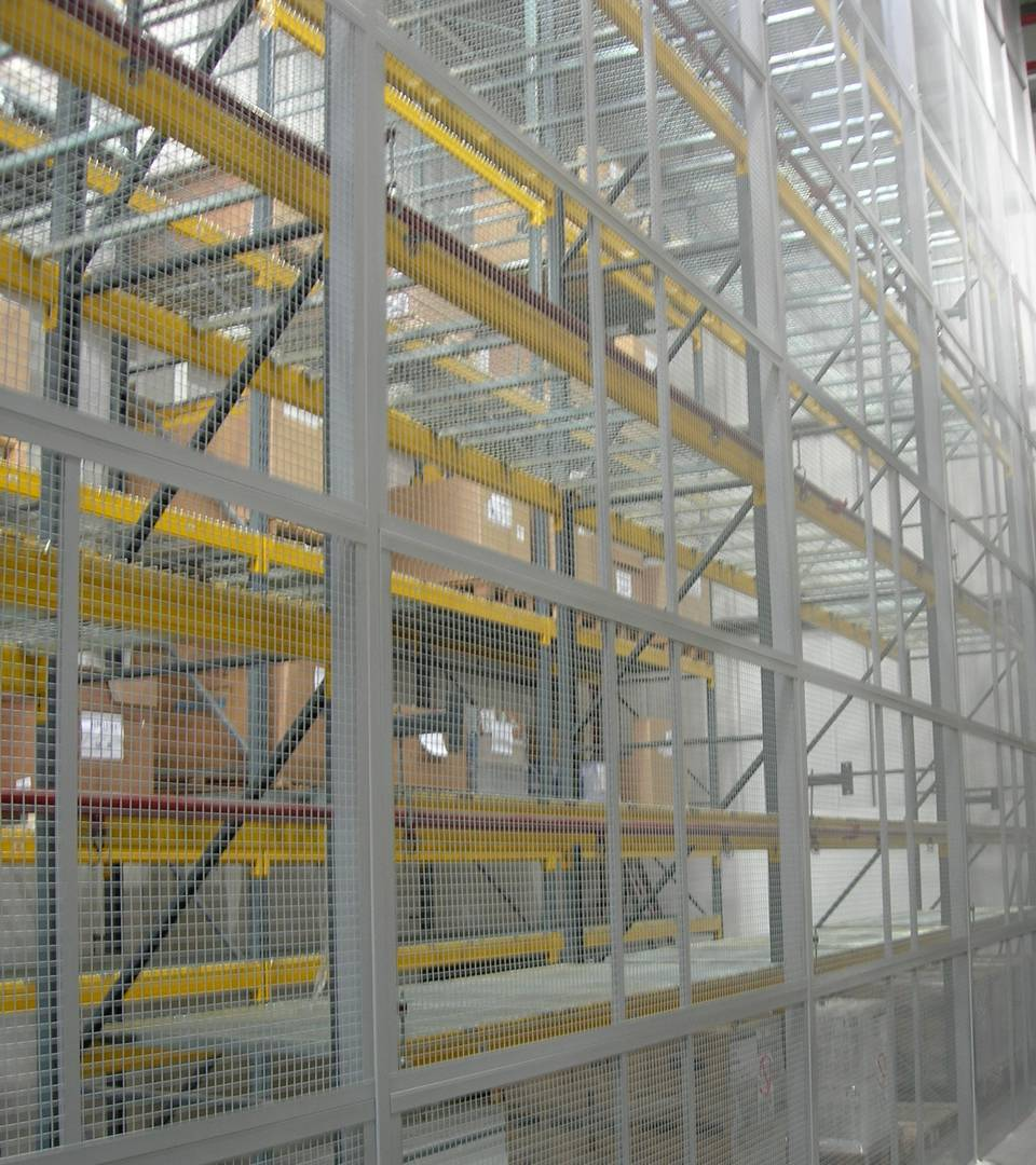 Gray welded wire mesh partition with metal frame is like a wall for protecting the goods.
