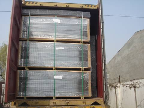 Four pallets of welded wire mesh panels in the container.