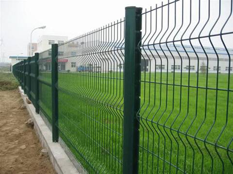 Several 3D security fence panels are installed surrounding the factory with peach posts.